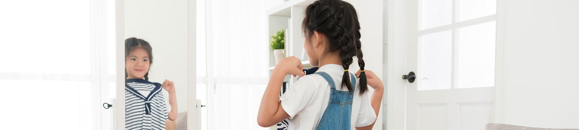 A importância de deixar as crianças se vestirem
